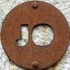 JO (chrisinplymouth) Tags: squircle circle round letters metal iron rust rusting corrosion corroded cw69x twoletter alphabet doublet jo cutout sign steel mountbatten plymouth devon unitedkingdom england uk plate disc rusty nauticaltelegraphcode sculpture art squaredcircle oxidation