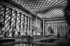 Amazing Atrium (` Toshio ') Tags: light shadow people blackandwhite bw woman man art water silhouette museum person washingtondc smithsonian dc washington cafe interior courtyard american atrium musuem nationalportraitgallery toshio x100 smithsonianamericanartmuseum kogodcourtyard fujix100