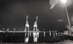 cranes (Russel Ocsan Photography) Tags: seattle longexposure bw canon exposure downtown nw waterfront naturallight lensflare 1740mm russelocsanphotography