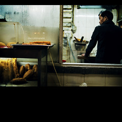 man behind the food (Explored) (Chez C.- busy again) Tags: street man window breakfast hongkong deep stall olympus getty fried gettyimages streetshot epl2