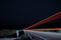 long lost in america (pbo31) Tags: longexposure sky motion black color june night dark stars lights lowlight nikon lasvegas infinity nevada passing roadside 2012 roadway lightstream northlasvegas lincolncounty highway93 d700 thegreatbasinhighway