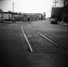 The longest year that had me down (QsySue) Tags: city railroad blackandwhite building train mediumformat losangeles downtown toycamera traintracks 120film vignetting expiredfilm artsdistrict artistsdistrict developedathome holga120fn titleisakatatonialyric mysterybulkfilm probablykodaktmaxorsomethinglikethat