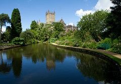 Summer Blue (Mukumbura) Tags: uk blue trees england sky lake church water pool beauty weather gardens architecture buildings reflections bench spring quiet peace cathedral unitedkingdom britain path seat religion tranquility wells somerset wellscathedral well clear moat magnificent grandeur bishopspalace peacefulscene