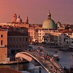 A rich and rosy sunset over Venezia (Bn) Tags: world street city trip travel bridge pink venice houses windows light sunset red summer people italy orange sun color reflection heritage history water beauty weather yellow