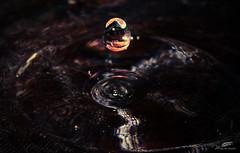 Golden droplet in the dark.. (wessoufi) Tags: water drop floating golden droplet reflection darkbackground goldenlight studio waterfigure watercolor yellow black creativeart waterart digitalart