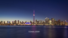 Toronto at Dusk (Sleg21) Tags: blue architecture building business canada canadian city cityscape cn color colorful downtown dusk evening financial harbor horizontal lake landmark light modern night office ontario panorama panoramic reflection silhouette sky skyline skyscraper sunset tall toronto tower travel twilight urban water waterfront