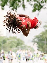 Outta Reach (Q Win) Tags: twist hair jump height action team white trampoline outdoor tumbling