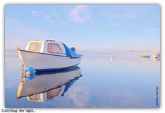 Catching the light.. (Nicolas Valentin) Tags: uk blue light sky lake nature water clouds landscape freedom scotland boat bravo scenery loch lomond lochlomond