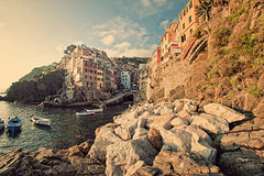 Postcard from Riomaggiore (Allard One) Tags: sunset italy water vintage boats coast spring nikon rocks village postcard liguria scenic panoramic cliffs retro fisheye vista coastline cinqueterre geography mei fishingboats commune lente region eclectic italie goldenhour harsh mediterraneansea bold riomaggiore vessels 2012 ansicht laspezia toning yellowed pittoresque famousplace locallandmark nationallandmark internationallandmark touristdestination singleraw nikcolorefexpro towerhouses d700 coastalvillage nikond700 gulfofgenoa mediterraneancountry nikonfx nikkor16mmf28fisheye allardone allard1 duohardstrak rimazuu fullframepower imagetrendsfisheyehemi allardschagercom