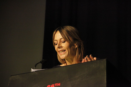 Kate Dickie presents the Michael Powell Award to Penny Woolcock and the One Mile Away cast at the 2012 EIFF Awards ceremony