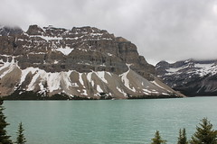 Bow Lake with snow cliffs (SteveKenzell) Tags: cliff lake snow canada tree green clouds alberta banffnationalpark