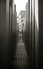 Pillars of the Past (Mike Kniec) Tags: pillars jewishmonument memorialtothemurderedjewsofeurope denkmalfrdieermordetenjudeneuropas holocaustmemorial berlin mmemorial monument distorted figure bw monochrome holocaustmahnmal history holocaust worldwar2 victims
