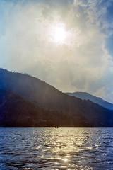 Shimmering (hiphopmilk) Tags: film analog analogue 135film 35mm kodak kodakfilm yashica yashicaj jaredyeh hiphopmilk nepal pokhara kaski gandaki phewa lake tal fewa sarangkot kaskikot boat ship canoe water sun sunshine mountain shimmering shimmer