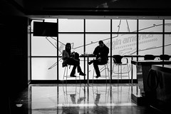 in flight meal (Super G) Tags: nikon262 candid woman man sitting bar backlit airplane virgin america silhouette bw blackandwhite