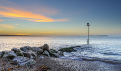 Calm Solent Dawn (nicklucas2) Tags: seascape beach isleofwight lighthouse sea groyne seaside solent wave cloud