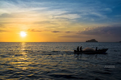 ... back home (JOMAGACOL) Tags: colombia sunset fisher sun red blue water pentax k1 jomaga silueta silhouette