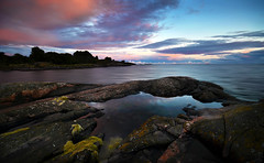 After The Rain #02 (tinamar789) Tags: colorful clouds water sea seashore seascape sunset rocks reflection red sky suomenlinna