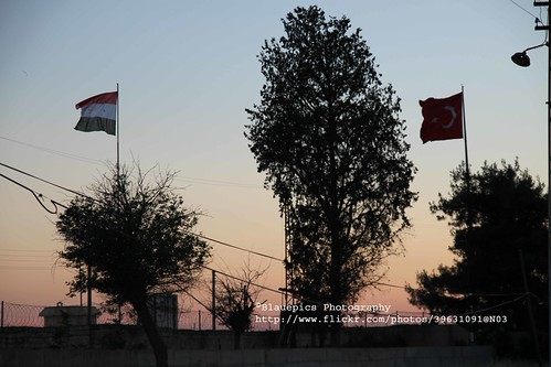 Karkamış, railway station, flags, border to Syria at sunset