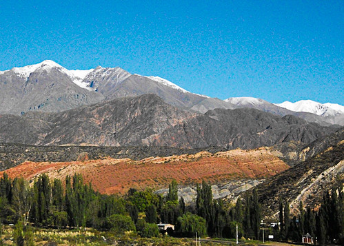 <p>The colorful hills and fresh snow on the mountains of Potrerillos, Argentina. </p>