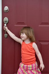 June 22, 2012_14 (Kim_Reimer) Tags: door pink red baby canada silly color cute girl childhood handle kid toddler child bc outdoor britishcolumbia daughter adorable posing skirt innocence tanktop northamerica carefree 2yearsold sleeveless gettyimagescanada