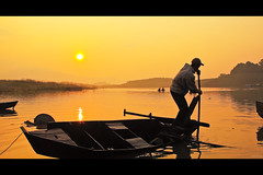 A new day (-clicking-) Tags: life lighting light sun lake reflection water beautiful silhouette yellow contrast sunrise dawn golden boat waves floating sunny newday hardlife goldensunrise bolc bnhminh hami rememberthatmomentlevel1 rememberthatmomentlevel2 rememberthatmomentlevel3