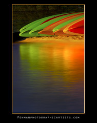 Kayak Sherbet (Dustin Penman) Tags: california longexposure pink sunset red orange usa lake abstract green beach water colors yellow contrast america landscape bay nikon long united nevada tahoe sierra shore canoes warmlight 7000 dusin penman d7000 nikond7000