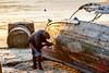 Patching the Boat (DragonSpeed) Tags: africa beach mercurys stonetown tzday08 tanzania zanzibar boatrepair working zanzibartown zanzibarurbanwest tz