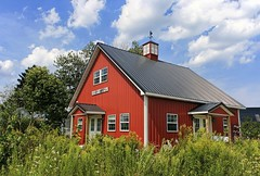 The Cannery, At An Angle, With Flowers (~ Liberty Images) Tags: flagged ohio glassroostercannery summer summertime green verdant sunburyoh libertyimages americana redbarn building architecture weathervane metalroofforthewin