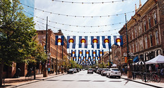 coloradan (almostsummersky) Tags: string denver street brick city windows lowerdowntown hanging lights buildings summer urban road tree travel umbrella state colorado cars parked lodo flags larimerstreet downtown unitedstates us