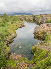 Rocky pool (James E. Petts) Tags: iceland thingvellir polariser pool rock water