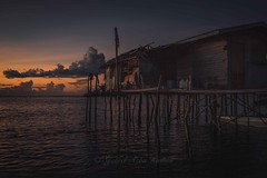 Wooden house at sunrise (Syahrel Azha Hashim) Tags: horizon seagypsies sony 2016 shallow early nopeople simple morning housesonstilts details dramaticsky house semporna sabah boat ilce7m2 dof woodenhouse denawanisland sunrise simplelife a7ii getaway handheld 35mm colorimage vacation residential prime clouds sonya7 naturallight fishingvillage colorful island beautiful travel syahrel clearsky malaysia colors slowshutter holiday ocean light detail