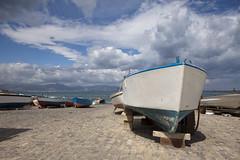 Barche ad Aspra. (Di Vinti) Tags: italien italy canon italia nuvole barche sicily palermo spiaggia sicilia pescatori aspra canon50d fotosicilia sicilyphoto