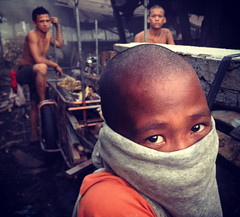 Ulingan, Tondo - Forget not the children (Mio Cade) Tags: boy portrait eye mood factory smoke philippines charcoal manila iphone tondo ulingan instagram