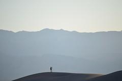 far-away photographer (Wade Bryant) Tags: camera woman mountain evening sand dunes tripod ranges distant deathvally nikon55200mmf456