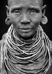 Portrait Of A Karo Woman With Beaded Necklaces And Earrings Ethi (Eric Lafforgue) Tags: africa portrait people bw woman vertical closeup kara necklace beads women interior picture earring tribal indoors photograph blackpeople omovalley shorthair ethiopia tribe karo beaded frontview dozy hornofafrica nomadic abyssinia blackandwhitephoto onepersononly humanface onewomanonly lookingatcamera indigenousculture snnpr southernethiopia blackwhitepicture 8097 truepeople 4549years korcho kerre 5054years omotic southernnationsnationalitiesandpeoplesregion blackethnicity ethiopianomovalley ethio8097