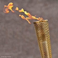 The torch in Burrelton (P&KC Archive) Tags: sport photography scotland community perthshire streetscene celebration 20thcentury relay olympicflame torchrelay localhistory olympictorch torchbearers historicevent civicpride perthandkinross ecsochistory recordinghistory