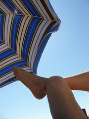 Relax (Annie in Beziers) Tags: summer sun man france beach foot reading legs sandy relaxing parasol plage tanning striped sunbather homme putyourfeetup vendres anneinbziers