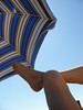 Relax (Annie in Beziers) Tags: summer sun man france beach foot reading legs sandy relaxing parasol plage tanning striped sunbather homme putyourfeetup vendres anneinbéziers