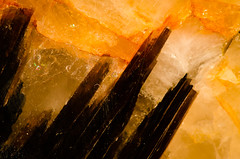 Fortress of Solitude, Sunset (Johnath) Tags: sunset orange brown sun abstract black macro rock crystal spire granite countertop crystalline fortressofsolitude
