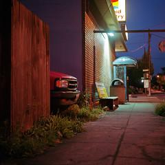 Peek (bnzai9) Tags: street summer bus oregon truck fence dark portland dawn store minolta kodak sidewalk 400 1956 portra autocord mxs autaut