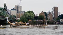 Olympic Gloriana barges past Hammersmith (Tobymutz) Tags: london boat hammersmith flame riverthames cauldron hammersmithbridge oars rowers olympictorch londonist oarsmen royalbarge gloriana goldentorch