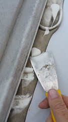 Scraping off the old sealant (JD and Beastlet) Tags: camper travel trailer rv 2012 rockwood 2701ss slide 27 foot recreational vehicle camping camp campering family vacation together bonding nature front bedroom vent fan fantastic 807350 with digital wireless remote thermostat reversing rain sensor fourteen 14 speeds