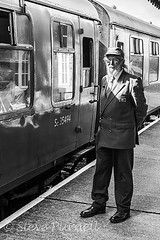 The Stationmaster 1 (Steve Purnell Photography) Tags: stationmaster station travel train transport rail conductor railroad tourism transportation symbol trip employee hat background jacket people tie uniform professional happy safety holiday mustache isolated service old thumb tour person