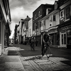 Shadow Bike (JennTurner) Tags: light white black 6x6 film buildings cyclists town kent shadows kodak mat 124g shops medium format cobbles yashica 120mm faversham 100iso bicylces