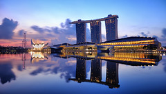 Marina Bay Sands Hotel, Early Morning Landscape (badzmanaois) Tags: park city travel bridge blue light sky urban cloud reflection building tower tourism beautiful beauty skyline architecture modern night skyscraper marina river garden landscape outdoors hotel bay twilight construction singapore colorful asia cityscape dusk landmark center scene icon casino double resort cranes business trail works helix rays sands luxury integrated