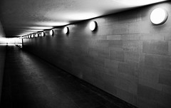 Walking Underground in the Tunnel (Blue Rave) Tags: light blackandwhite bw berlin wall germany underground deutschland lights vanishingpoint europa europe path illumination tunnel illuminated diagonal pathway 2012 siegessule victorycolumn