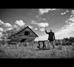 Levitate me (martinfowlie) Tags: sky canada man abandoned clouds barn canon levitation whiskey alberta 7d 1020mm pixies suitcase twisted ruraldecay loner magician the levitateme
