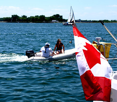 Proud of our Canadian flag (Trinimusic2008 - stay blessed) Tags: trees friends urban toronto ontario canada nature water sunshine outdoors sand candid flag hats streetphotography sunny shade lakeshore harbourfront to blueskies peoplewatching canadianfemalephotographers htopark trinimusic2008 mygearandme ringexcellence judymeikle flickrstruereflection1 happycanadadayfêteducanada