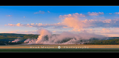 Yellowstone Morning - Wyoming (~ Floydian ~) Tags: morning trees sky panorama usa cloud color tree fountain colors fog clouds sunrise canon landscape dawn landscapes nationalpark colorful warm mood colours view unitedstates pano smoke wide atmosphere panoramic steam valley yellowstone wyoming np geyser meijer henk geysers wideview basins midwaygeyserbasin paintpot floydian colourfulclouds canoneos1dsmarkiii henkmeijer
