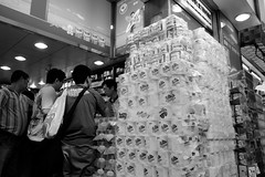 Not afraid of diarrhea (Dennis Wong) Tags: street blackandwhite white black paper photography hongkong fuji market tissue toilet snap hong kong fujifilm drugstore 香港 黑白 northpoint hongkongisland lightroom diarrhea 街拍 抓拍 厠紙 北角 marbleroad 馬寶道 fuji18mmf2
